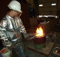UNI metal casting student heating metal for molds