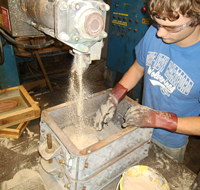 UNI metal casting student working with sand casting