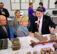 Hillary Clinton visiting the UNI Metal Casting Center and 3D Printer