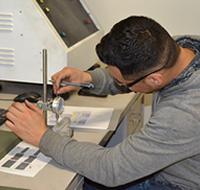 UNI MCC student preparing for the molding process